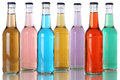 Colorful soda drinks with cola in bottles soft Stock Image