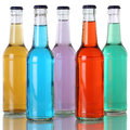 Colorful soda and soft drinks in bottles with reflection Royalty Free Stock Photo