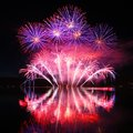 Colorful spectacular fireworks with reflections in the water Stock Image