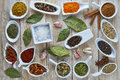 Colorful spices assortment on a wooden talbe in the kitchen Royalty Free Stock Photo