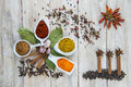 Colorful spices assortment on a wooden talbe in the kitchen Stock Photos