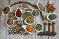 Colorful spices assortment on a wooden talbe in the kitchen Stock Images