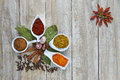 Colorful spices assortment on a wooden talbe in the kitchen Royalty Free Stock Photography