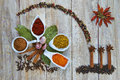 Colorful spices assortment on a wooden talbe in the kitchen Royalty Free Stock Image