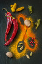 Colorful spices chili turmeric cardamom nutmeg and lemon grass design on a blackboard chalk bright the chalkboard Royalty Free Stock Image