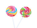 Colorful spiral lollipop candy on stick, isolated on white background. (clipping path) Royalty Free Stock Photo