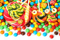 Colorful spiral lollipop with chocolate coated candy Royalty Free Stock Photo