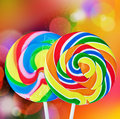 Colorful spiral lollipop isolated on a colored background Stock Images