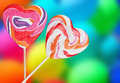 Colorful spiral lollipops on a colored background Royalty Free Stock Images