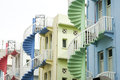 Colorful spiral staircases at the back of traditional chinese shop houses in singapore city Royalty Free Stock Image