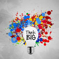 Colorful splash colors lightbulb crumpled paper think big word with background as concept Royalty Free Stock Photos