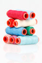 Colorful spools of thread a few which laid out neatly Royalty Free Stock Photo