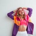 Colorful sportive girl posing in studio Royalty Free Stock Photo