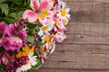Colorful Spring bouquet of flowers on the wooden background.