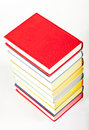 Colorful stacked books on neutral background Royalty Free Stock Images