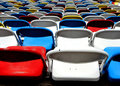 Colorful stadium chairs rows of seats Royalty Free Stock Image