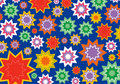 Colorful star flower on blue Royalty Free Stock Images