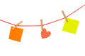 Colorful stickies hanged on red rope Royalty Free Stock Photos