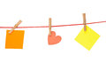 Colorful stickies hanged red rope isolated white Royalty Free Stock Image