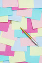Colorful sticky notes on cork bulletin board Royalty Free Stock Photo