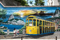 Colorful street art depicting a bond tram driving above the city Royalty Free Stock Photo
