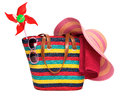 Colorful striped beach bag with a straw hat towel sunglasses and Royalty Free Stock Photo
