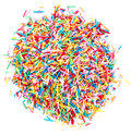 Colorful sugar candy sprinkles isolated on white background top view Stock Images