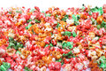 Colorful sugared popcorn isolated on white Royalty Free Stock Photo