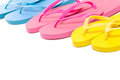 Colorful summer flip flop shoes over white background Royalty Free Stock Photos