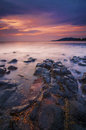 Colorful sunrise over the sea at black stone beach kuantan Stock Image
