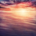 Colorful sunset abstract nature summer or spring ocean sea background small waves on water surface in motion blur at Royalty Free Stock Images