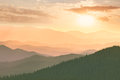 Colorful sunset in the mountains hills sun and sky ukraine europe Royalty Free Stock Photo