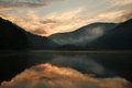 Colorful sunset over the lake in mountains with sky reflection water Stock Image