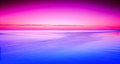 Colorful sunset purple over beach and ocean Royalty Free Stock Image