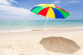 Colorful sunshade at a lonesome tropical beach le morne maurtius africa Stock Photos
