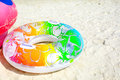 Colorful swim ring on white sand Royalty Free Stock Photo