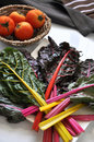 Colorful Swiss Chard on Plate with Tomato Royalty Free Stock Photo