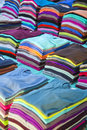 Colorful t shirts piles of new Royalty Free Stock Image