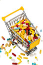 Colorful tablets in cart the shopping icon photo for healthcare costs pharmacies abundance of drugs Royalty Free Stock Images