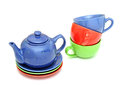 Colorful tea cups with teapot on white Stock Image