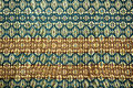 Colorful thai silk handcraft peruvian style rug surface close up Royalty Free Stock Photo