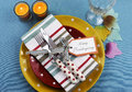 Colorful thanksgiving dining table setting bright modern happy in red yellow and aqua blue colors with polka dot and stripes Stock Image