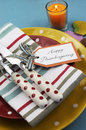 Colorful thanksgiving dining table setting close up bright modern happy in red yellow and aqua blue colors with polka dot and Royalty Free Stock Photos
