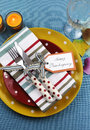 Colorful thanksgiving dining table setting vertical bright modern happy in red yellow and aqua blue colors with polka dot and Royalty Free Stock Images
