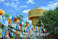 Colorful tibetian flags and biggest buddhist wheel in the world