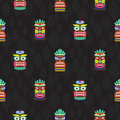 Colorful tiki masks totems seamless dark pattern vector.