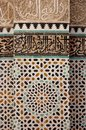 Colorful tiles with Arabic inscriptions in Marrakesh, Morocco bazaar