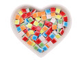 Colorful tiles closeup of in heart shape plate Royalty Free Stock Photo