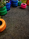 Colorful tires for plants piled up as planters flowers Stock Image