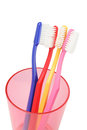 Colorful toothbrushes in plastic container on white background Stock Photography